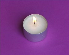 Candle on purple bacground Stock Footage