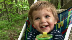 Boy in Stroller with Drink Looking Up Stock Footage