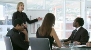 Stock Video Footage of Businesswoman explaning business results to her team