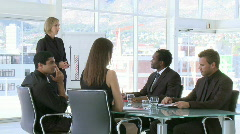 Businesswoman explaning instructions to her team Stock Footage