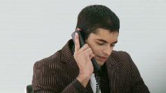 Hispanic Businessman talking on his phone Stock Footage