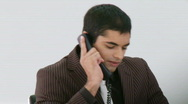 Stock Video Footage of Hispanic Businessman talking on his phone