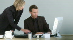 Two associates discussing on a desktop Stock Footage