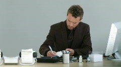 Businessman working on his deask with a phone Stock Footage