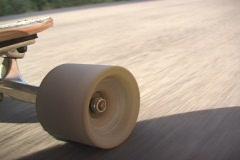 Longboard wheel in action Stock Footage