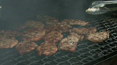 Grilling steaks on a barbecue Stock Footage