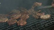 Stock Video Footage of Grilling steaks on a barbecue