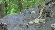 Stock Video Footage of Water Running off the Side of Rocks