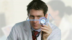 Doctor listening to a stethoscope Stock Footage
