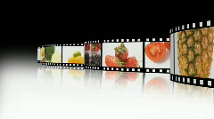 Assortment of Fruit and veg on a film reel - stock footage