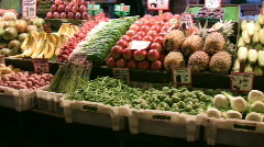 Stock Video Footage of Produce stand panning shot showing beautiful, colorful fruits and vegetables.