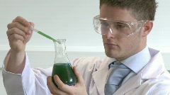 Stock Video Footage of Lab Technical examining chemcial