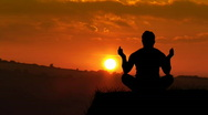Stock Video Footage of Man meditating at Sunset