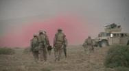Men carrying wounded after Humvee hit a bomb (HD)   m Stock Footage
