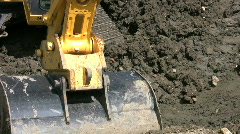 Excavator bucket digging earthworks on a building site. Stock Footage