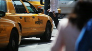 Close up of NYC taxis and pedestrians Stock Footage