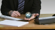 Businessman with a rotary terrestrial globe in his open hand Stock Footage