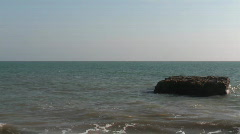 rock in the sea - stock footage