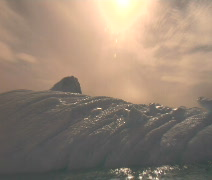 Iceberg reflecting sun in Antarctica - stock footage