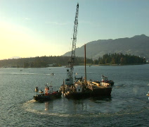 Barge, Crane & tugboat construction in Vancouver harbor Stock Footage