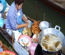 Thai women Cooking on boat overhead - stock footage