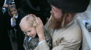 Stock Video Footage of First haircut at Hasidic celebration of Lag B'omer in Meron