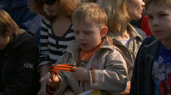 Child in crowd Stock Footage
