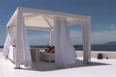 Hotel terrasse with white tent and sea in background Stock Footage