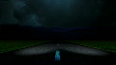 HD Traveling at a high rate of speed down a lonesome road toward a storm Stock Footage
