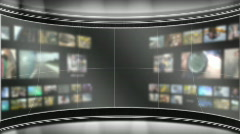 HD Virtual TV studio set with multiple background monitors playing Stock Footage