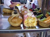 Arranging desserts on a dish Stock Footage