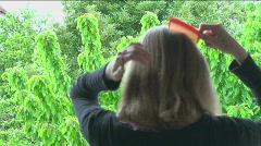 Girl Combs Hair Stock Footage