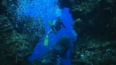 Diver through caves Stock Footage