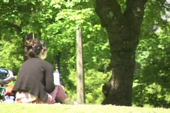 Young Woman Writing and Reading in Park 3 Stock Footage
