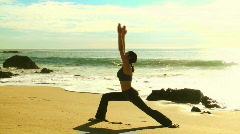 Yoga warrior pose by the ocean - HD  Stock Footage