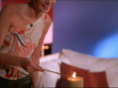 Woman lights candle Stock Footage