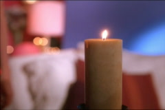 Single candle in living room Stock Footage