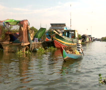 Market on boat in Cambodia water village Stock Footage