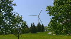 Large Wind Turbine Seen From A City Park Stock Footage