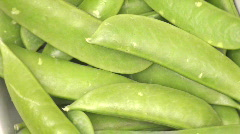Sugar snap peas zoom out - HD - stock footage