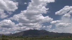 Taos Mountain with clouds Time Lapse Stock Footage