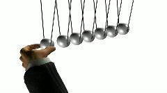 Hand starts pendulum with balls Stock Footage