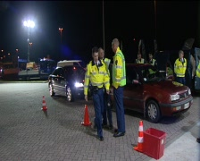 Dutch police searching cars for weapons drugs and testing driver for alcohol Stock Footage