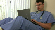 Stock Video Footage of Doctor Working on Laptop