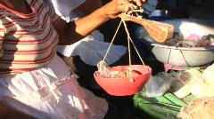 Weighing flour at market Granada, Nicaragua Stock Footage