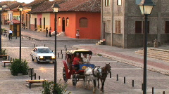 Horse carriage passes by Granada, Nicaragua Stock Footage