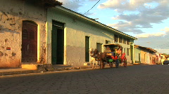 Horse carriage passes by in Granada, Nicaragua Stock Footage