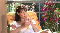 HD1080i Young brunette sexy woman on balcony drink beverage Stock Footage