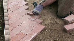 Paving a garden path Stock Footage