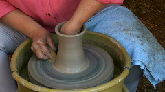 Potter shaping pottery on potters wheel Stock Footage